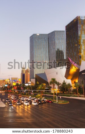 LAS VEGAS, NV- JULY 13, 2013: Cars waiting the green light on Las Vegas strip at sunset, near City Center Place.