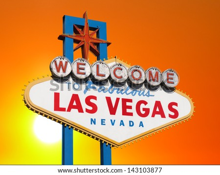 Las Vegas welcome sign with sunset sky.