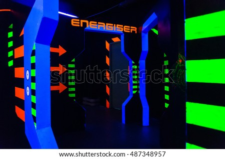 Laser tag play arena with fluorescent paint, energiser room