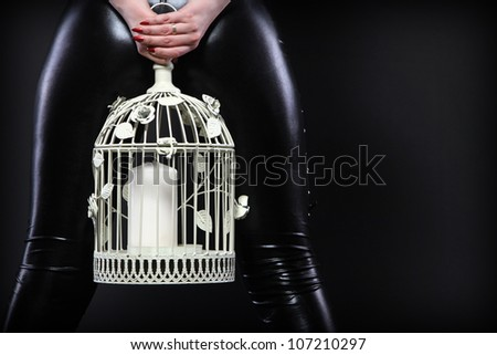 Latex woman with cage