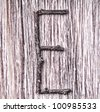 Latin capital alphabet letter E made from  sticks on vintage surface - stock photo