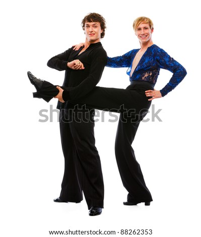 Latino male dancer holding leg of his funny posing friend