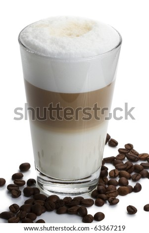 latte macchiato with coffee beans on white background