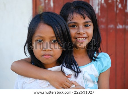 LAUBAN BAJO,INDONESIA - CIRCA AUGUST,2007 - Girls pose for a photo in Labuan Bajo (Flores island).