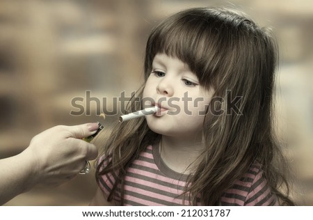 Little naked girl smoking