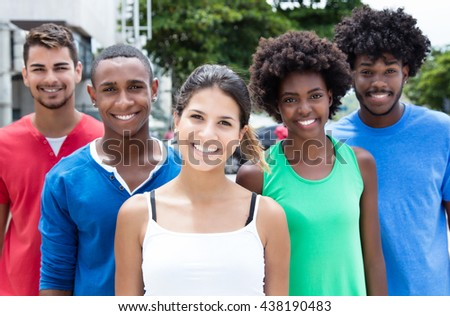 Laughing caucasian girl with group of multiethnic friends