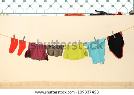 Laundry line with clothes on a sandy backround