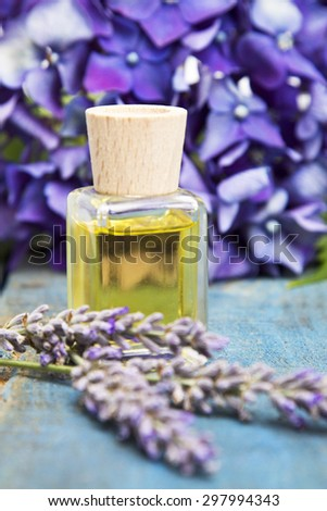 lavender and oil on wooden background