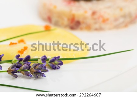 Lavender branches and delicious mousse for salmon tartar with black truffle sauce. Macro. Photo can be used as a whole background.