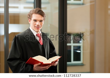 Lawyer with civil law code in a court room
