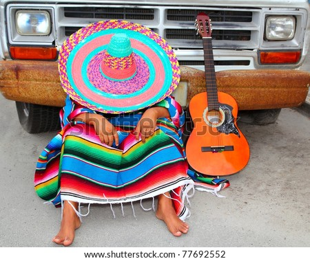 Lazy nap mexican guy sleeping on grunge car with guitar and poncho