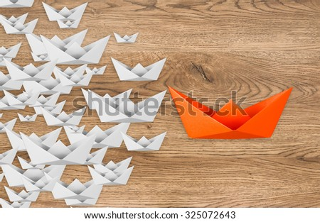 leadership concept with paper boat