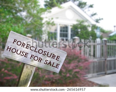 Real estate concept businessman hand holding stock photo for Modern family home for sale