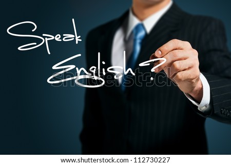 Learning English. Man writes on the screen Speak