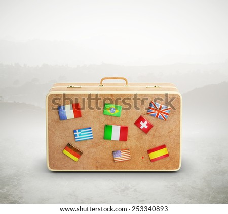leather suitcase with many flags, close up