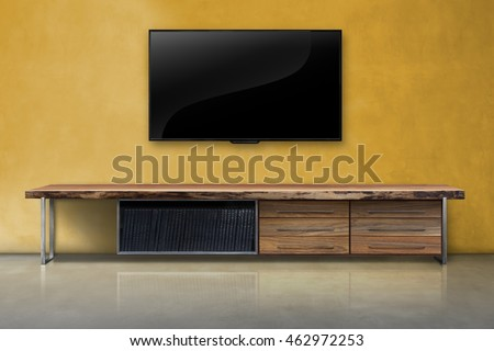 Led tv on color concrete wall with wooden table living room interior vintage style
