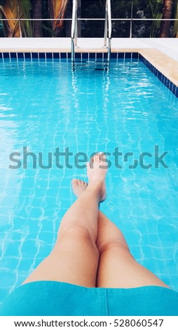 Legs in the swimming pool.