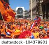LEIPZIG, GERMANY - JUNE 11, 2006: Supporters of the National Soccer Team of the Netherlands on June 11, 2006 in Leipzig, Germany. They are  dressed in orange, being the National Color of Holland. - stock photo