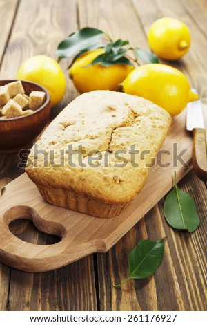 Lemon cake and cane sugar on the wooden table