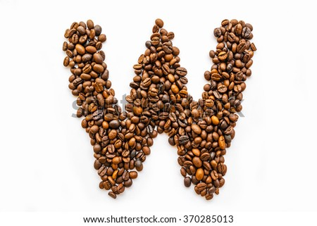 Letters made of coffee beans on the white background.