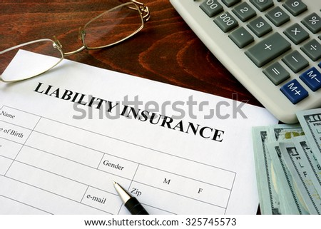 Liability insurance  form and dollars on the table.