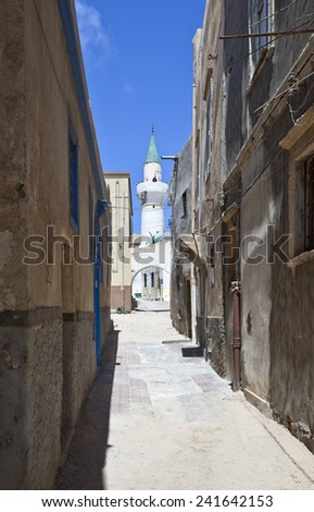 Libya,Tripoli, an alley of the old Medina with a minaret in the background