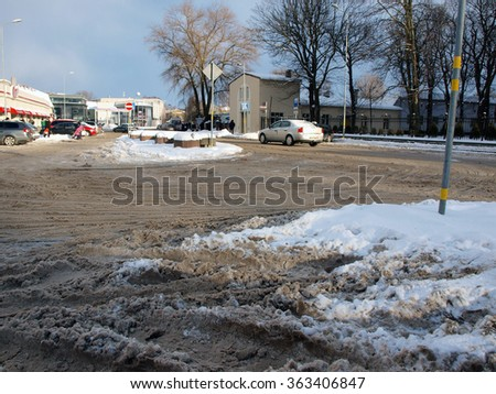 LIEPAJA, LATVIA - JANUARY 13, 2016: Streets are covered with wet snow and are slippery and dangerous for car traffic and pedestrians.