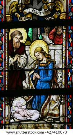 LIER, BELGIUM - MAY 16, 2015: Stained Glass window in St Gummarus Church in Lier, Belgium, depicting a Nativity Scene at Christmas