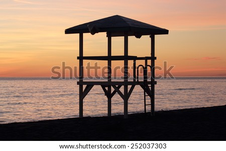 lifeguard tower silhouette in Ostia beach, Rome, Italy