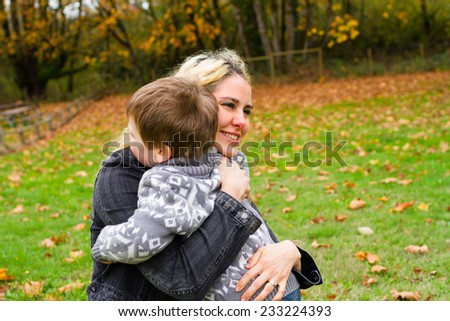 Lifestyle portrait of a mother and her son outdoors in the Fall.