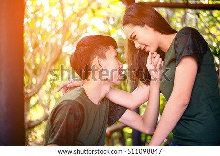 lifestyle toned image of young couple in love hugging.Couple having fun on their summer holiday.