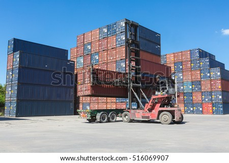 Lifting empty container to keep in container stack by reach stacker