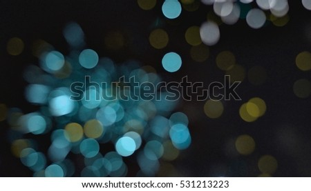 Light blur and defocus bokeh circles on black sky background