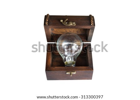 light bulb in a wood chest