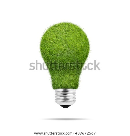Light bulb with green grass isolated over white background