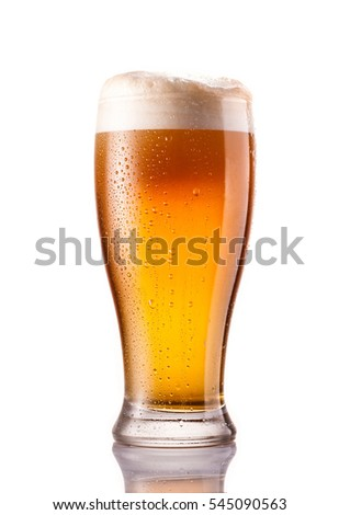 light cold beer in frosty glass isolated on a white background