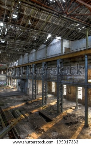 Light coming through large windows in an abandoned hall