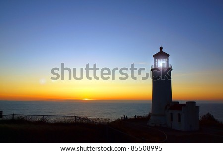 Light Shining in the North Head Lighthouse on the Washington Coast at Sunset