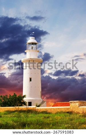 Lighthouse and beautiful sky sunset. Paphos Lighthouse was built in 1888.