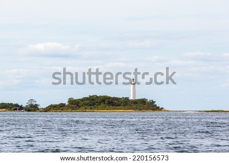 Lighthouse on an island in the sea