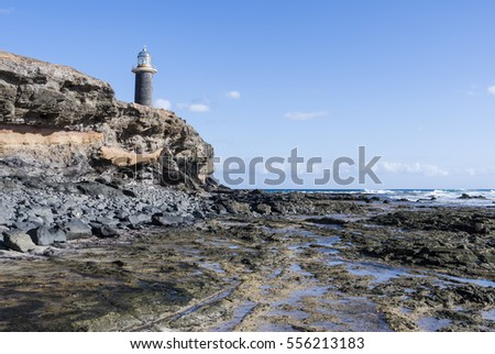 Lighthouse on Fuerteventura Canary Islands called Faro de Jandia at a cliff on the south cape of the island.