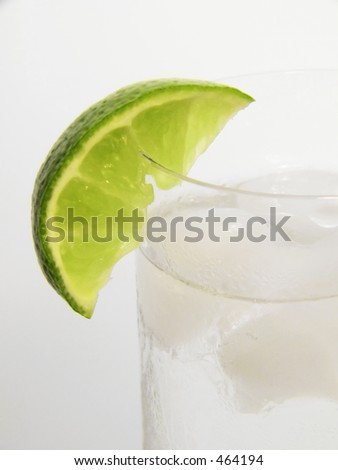 lime wedge on chilled glass of gin and tonic