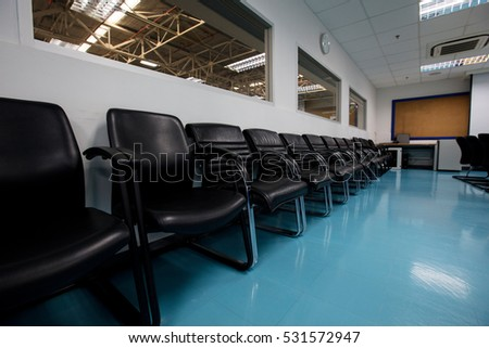 line of chair in meeting room