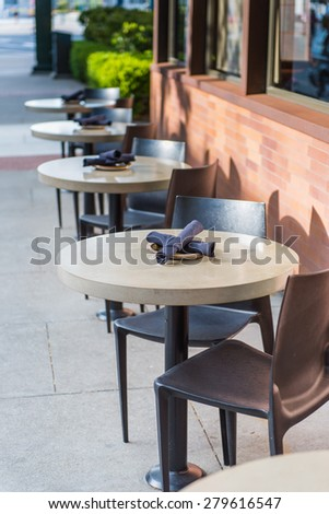 Line of set tables in restaurant