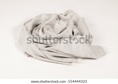 Linen scarf with tassels on white background, scarf top view .