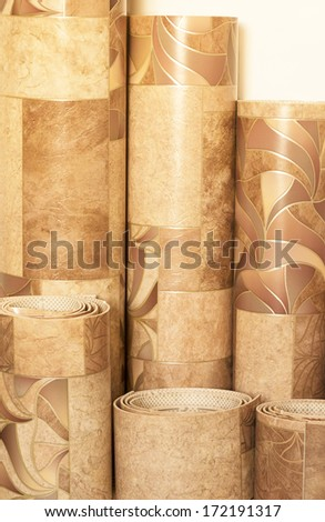 linoleum pieces, rolled into tubes