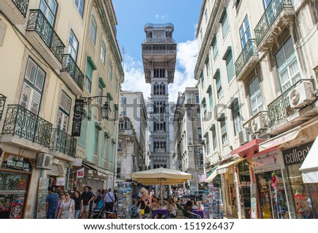 LISBON, PORTUGAL - JULY 27: Santa Justa elevator in Lisbon, Portugal on July 27, 2013. The elevator was built by Raoul Mesnard in 1902 to connect Baixa Pombalina and Chiado