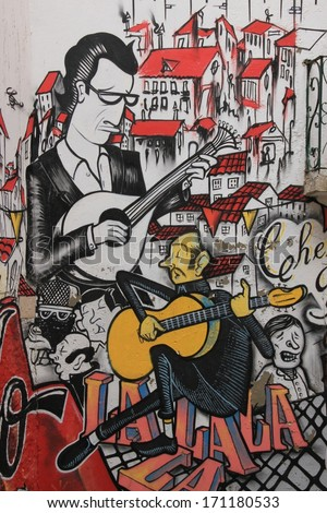 Lissabon, Portugal, November 5, 2013. Anonymous graffiti image shows singer traditional portuguese fado. Graffiti is located in old city.