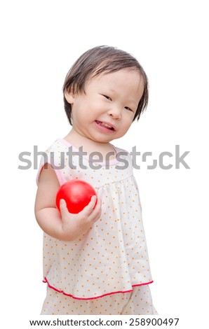 Little asian girl holding red ball over white background