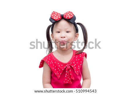 Little asian girl in red dress over white